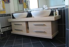 Suspended bleached durmast cabinet. Double ceramic sink and drawers with fronts in batting.