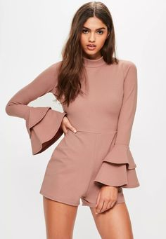 get your thrills in frills wearing this pink playsuit - featuring a high neck, long sleeves and frill details.