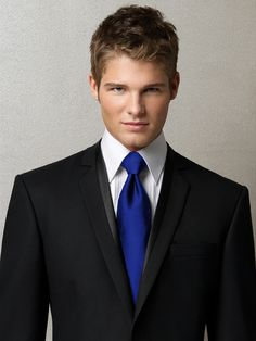 Black suit, royal blue tie. instead of black suit a white suit