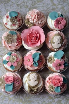 These vintage-themed cupcakes feature flowers in gold, pink and teal, as well as intricate fondant cameos.