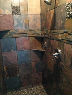 Finished slate tile and beach stone shower!!I like how they used two similar style stones in the shower.