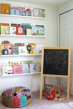 Stunning Kids Corner Design With Colorful Floor Cushion And Small Black Board Under Floating White Bookshelves On Clean White Wall Exciting Kids Corner Design Ideas for Play and Study Area Decoration, Kid's and Nursery Kids Play Corner, Kids Play Area, Furniture Layout, Home Furniture, Baker Furniture, Reading Wall, Reading Nooks, Kids Reading, Deco Kids