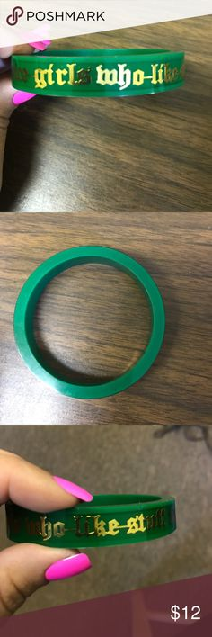 "Juicy Couture Bangle Juicy Couture green hard plastic bangle bracelet. Written around the entire bracelet in gold is ""for nice girls who like stuff"" in an Old English font. 1/4"" thick. Circumstance: 9.5"". I have a very small wrist & this is not as loose hanging as most are commonly made. Cute, chic, & a great stand-alone or pair with others Piece! Never worn! Juicy Couture Jewelry Bracelets"
