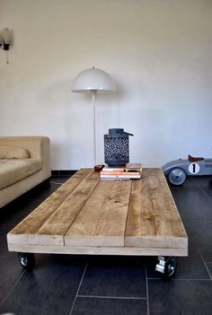 diy table /wood table- I love the rollers and the lowness of the table is interesting for a mod apt and mod furniture. Love this table. I need to make this table. Mod Furniture, Wooden Furniture, Furniture Design, Furniture Ideas, Wooden Desk, House Furniture, Furniture Stores, Sweet Home, Diy Casa