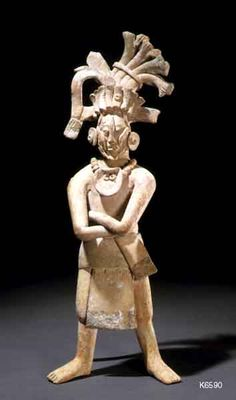 Maya. Jaina. clay traces of paint. height 23.4 cm. Dignitary wearing elaborate headdress and necklace with shell. He also wears cheek pieces. Owner LACMA