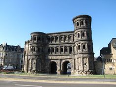 """History: In the image above we see the Porta Nigra. It is a Roman gate from 200 BC. It translates to """"Black Gate""""."""