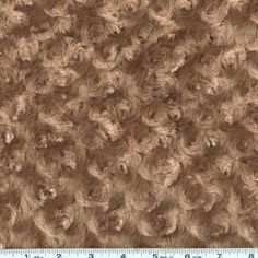 Minky Rose Cuddle Mocha from @fabricdotcom  This ultra plush and cuddly fabric has a silky surface with rosette embossing. 12 mm pile, 600 grams and is perfect for creating blankets, baby accessories, plush toys, and more!