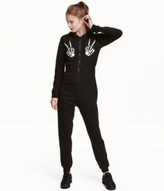 Black. Jumpsuit in cotton jersey with a printed motif at front. Drawstring hood, zip at front, and elastic at sides of waist. Ribbing at cuffs and hems.