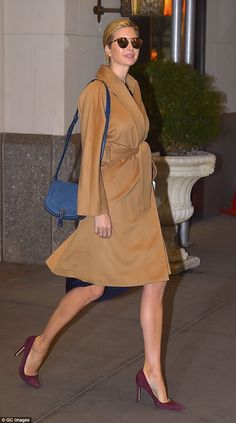 On the go: Ivanka Trump gave photographers a small smile as she stepped out of her Park Avenue apartment on Tuesday morning