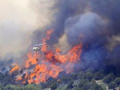 fire fighting helicopters | Fire fighting helicopter drops water