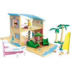"""Strandhuis """"Caribic"""" is een leuk opvouwbaar poppenhuisje die niet alleen handig is om mee te nemen maar ook van alle gemakken is voor zien. Het huisje is van twee kanten bespeelbaar en is van binnen en buiten kleurig beschilderd.Het huisje wordt gelever met alle accessoires die bestaan uit:palmbomen, surfplank, keuken tafel, keuken stoel, twee zonnenbanken, parasol, TV met TV tafel, tweepersoons-bed, en twee poppetjes,Afmetingen dichtgeklapt: ca. 23 x 11 x 20 cmAfmetingen uitgeklapt: ca.45…"""