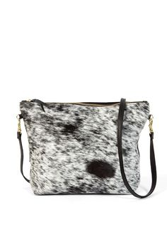 bc21f6cdb1a8 This one-of-a-kind purse by Primecut is handmade of byproduct Brazilian  cowhide and is the perfect size for an everyday carry. Each cowhide piece  is unique ...