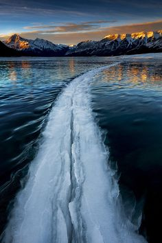 Into the Void  by Rob  Lafreniere  Large crack in a windy and frozen lake (Canadian Rockies).