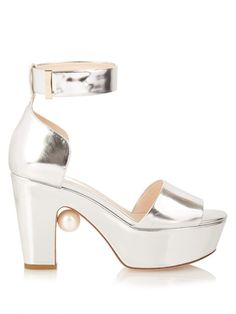 Nicholas Kirkwood's disco-ready Maya platforms shine in metallic-silver leather this season. They're a chunky, wearable style with a moderate block heel, and are finished with the designer's signature Swarovski pearl floating beneath the arch. Wear them with a colour-pop midi skirt for a high-octane result.