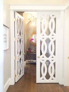 Cute door for living room to dinning.Also maybe use same pattern for kitchen cabinets