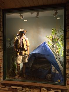 Hiking and camping themed display window at Bass Pro Shops.