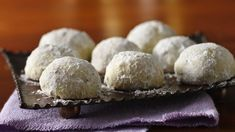 These buttery melt-in-your-mouth cookie balls go by many names in recipe collections, including Mexican Wedding Cakes. They always contain finely chopped nuts and are twice rolled in powdered sugar. This holiday favorite is one of Betty's Best!