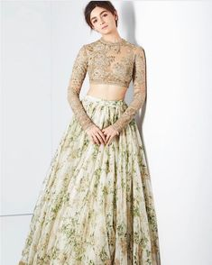 A popular sight at ceremonial occasions like festivals and weddings, the lehenga choli is a popular sight today. It is a three-piece attire comprising the lehenga, a long skirt that is worn with a fitting blouse called 'choli'. This is usually accompanied by a dupatta. The lehenga us generally embroidered, printed or embellished. #lehenga Indian Gowns Dresses, Prom Dresses With Sleeves, Indian Fashion Dresses, Indian Outfits, Evening Dresses, Dress Prom, Indian Bridesmaid Dresses, Party Wear Indian Dresses, Indian Clothes