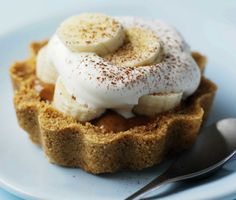 Mini Banoffee Pies... These little banoffees are perfect for a dinner party and super easy! Load the crushed biscuit bases with Carnation Caramel a few hours in advance and finish them off just before serving... Serves 6...