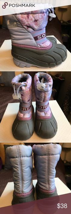 Sorel Cub Pac Boots Girls Sorel Cub Pac Boots Girls - Winter/Snow Boots Color: Sweet Pea/Wild Orchid  Size: 9 Details:  When kids have Sorel's Cub Pac boots, their feet stay warm in freezing temps and are safe from snow sneaking in. Comfort rated to -25F Durable water- and wind-resistant polyurethane-coated synthetic upper Built-in gaiter with barrel lock closure system Removable ThermoPlus felt inner bootie Injection-molded waterproof thermal rubber shell Rubber multi-directional lug…