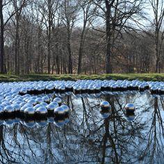 Yayoi Kusama installs 1,300 floating steel balls at Philip Johnson's Glass House estate