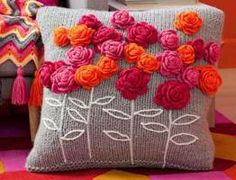 How to make a crochet flower pillow with knitted pillow... Maybe even upcycled sweater for the pillow.