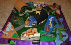 Tactile zoo travel play mat ; the only parts stitched down permanently are the railroad track border and gray sidewalks....all other pieces moveable and can be arranged a variety of ways.