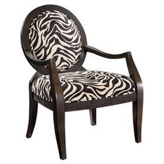 Wood arm chair with zebra-print upholstery.    Product: Chair   Construction Material: Wood and microsuede   Color: Brown cherry and beige  Features: Tapered legs and the precise curves   Savanna-inspired style with elegant contemporary design   Will enhance any dcor Dimensions: 39.25 H x 24.75 W x 26.5 D