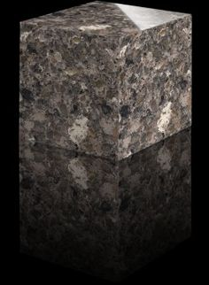 Mountain Mist - $58 a square foot for 2 cm thickness at Austin Granite Direct (that includes material, fabrication and installation).