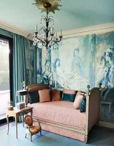 Petite chandelier with sunburst, pretty blues and blush pink; the wall covering is based on a painting by Tony Duquette's wife, Elizabeth. - the home of Hutton Wilkinson