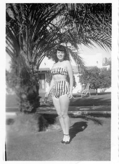 Posing in a striped swimsuit, 1940s.