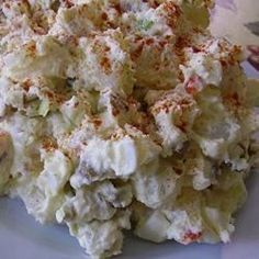 """This is a deliciously rich German potato salad, easy and perfect for summer BBQs. It is definitely full-flavored with bacon, green onions, sour cream, olives and other yummy ingredients...Always a hit with all our family and friends!"""