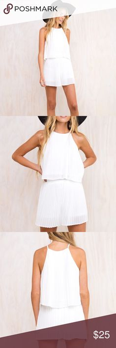 BRAND NEW Adorable white two piece set Brand New without tags!! So cute!! Pleated material with a high neck crop top and shorts that look almost like a skirt! Love this but didn't fit me right and too expensive to return since it's from australia :( it's from princess Polly but tagged Free People for exposure! Free People Pants Jumpsuits & Rompers