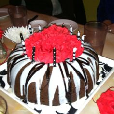 "Just made this for a friend. ""Too much chocolate cake"" from allrecipes.com.  Delicious! Everyone raved! Put beautiful red carnations in middle . Luv it!"