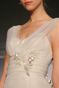 I Love the ethereal feeling of this dress. How ethereal the straps and bodice are. It is absolutely magnificent!!