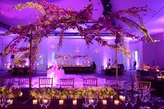 This enchanting head table décor consist of a gold metal frame with manzanita tree branches accented with white and purple dendrobuim orchids, green calla lilies, and hanging tear drop votives. Lower table decorated with long mirror box filled with green, purple, and ivory flowers along with romantic candle light votives. #weddings #flowers #backdrops #lighting #décor #yannidesignstudio