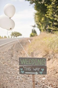Need a creative way to direct guests to the wedding? Try these cute signs with a balloon tied to the top! (Source: Elegant Wedding Invites) #weddingplanningadvice