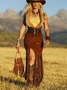 ~ Carriage Vest worn with Brit West's Wild West long fringe skirt, Corset Belt, hat, Belinda Tan Boots (Old Gringo, ya gotta have a good boot) and fringe purse.  As a woman enjoying mountain life in the great outdoors, it doesn't get any better than this. ~