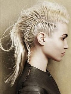 Braided Mohawk Hair Style Punk Girl Hairstyles pictures Make a smashing statement with a similar braided Mohawk hair style and show the best blueprint on how to rock out the hottest Punk looks of the season. Braided Mohawk Hairstyles, Mohawk Braid, Trendy Hairstyles, Girl Hairstyles, Braid Hair, Black Hairstyles, Mowhawk Hairstyles, Rocker Hairstyles, One Side Shaved Hairstyles