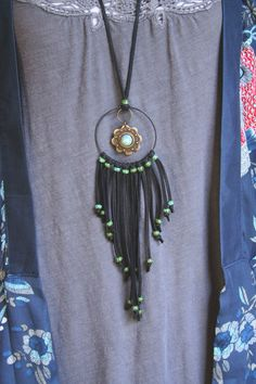 roots and feathers bohemian jewelry.... a possible DIY?