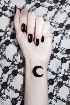 Moon tattoo.