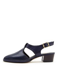 Closed toe sandals with an adjustable ankle strap and low heel.  Unfortunately these gems are no longer available...