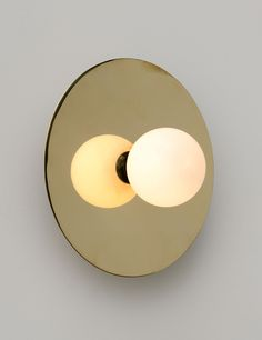 "Disc And Sphere Wall Light, design Atelier Areti. Founded by sisters Gwendolyn and Guillane Kerschbaumer, Areti's focus is on the production of beautiful, useful, well designed products that are made to last. (""Areti"" means virtue and excellence in Greek). All products are made in an environmentally conscious way by master craftsmen and small manufactures in Germany and Sweden."