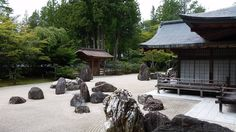 This is the Banryutei Rock Garden located on the grounds of Kongobu-ji temple Mount Koya.  At 2349 square metres it is the largest rock garden in Japan. It surrounds a small but very important hall called the Okuden.  140 granite rocks are carefully positioned among the immaculately raked white sand. The rocks were imported from Shikoku the place of birth of Kobo Daishi the legendary Buddhist monk and founder of Shingon Buddhism Kongobu-ji and indeed Koyasan. The white sand is from Kyoto…