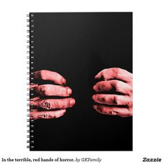 In the terrible, red hands of horror. spiral notebooks