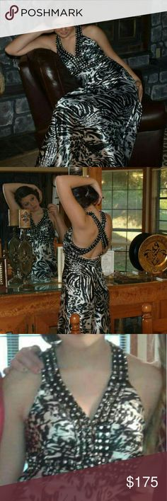 Zebra printed gown Beautiful zebra printed gown. Can be low cut. Floor length Dresses Prom