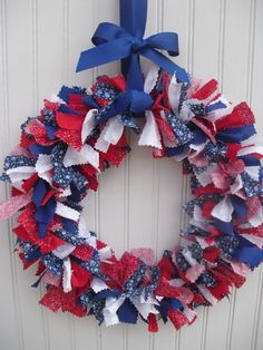 A beautiful, shabby-chic show of your patriotism! This wreath is handcrafted from strips of patriotic themed fabrics mimicking the traditional rag