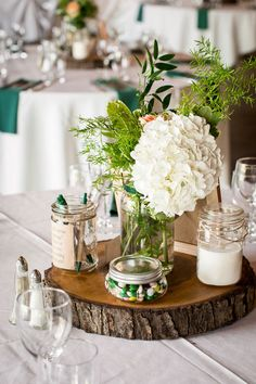 Nothing says fall like a rustic wedding! We love the use of natural earthy pieces such as this wooden slab for centrepieces.