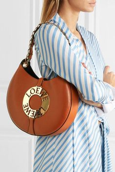 Tan leather (Calf) Snap-fastening tab at open top Comes with dust bag Weighs approximately Made in ItalyAs seen in The EDIT magazine Loewe Bag, Calvin Klein Underwear, Tan Leather, Saddle Bags, Leather Shoulder Bag, Calves, How To Wear, Dust Bag, Arm