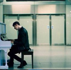 This picture means so much to me || Dan playing the piano is the most beautiful thing ever. I just love to hear him play it..